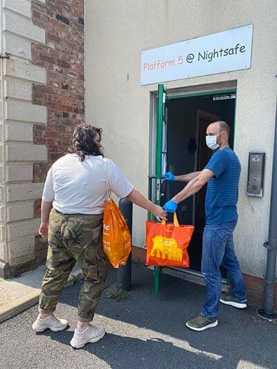 Wayne Bowman from Nightsafe hands out supplies, thanks for the Freemasons.